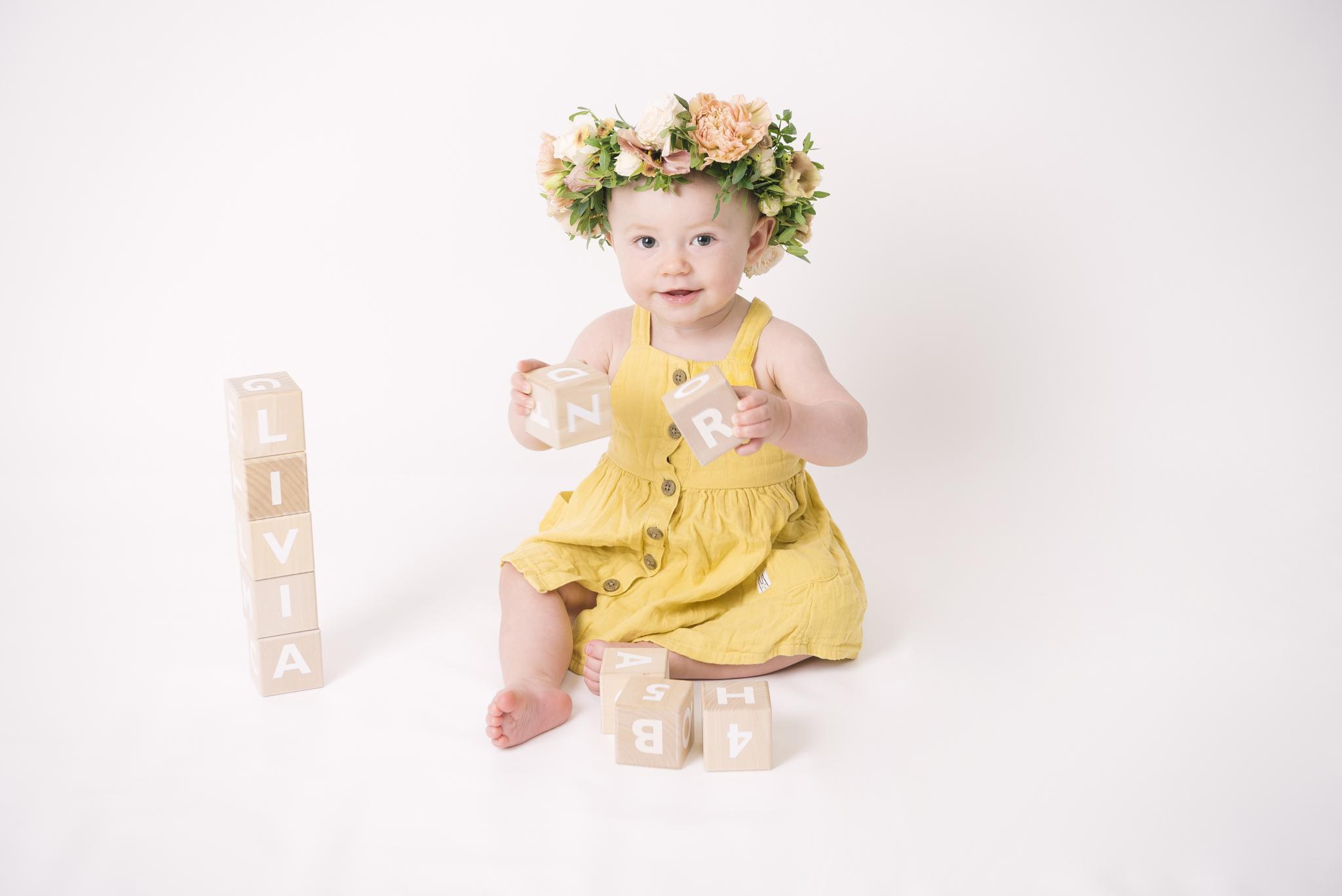 Ettårsfotografering med blomsterkrans
